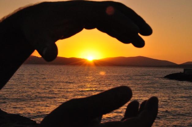 Catturo il tramonto tra le mani